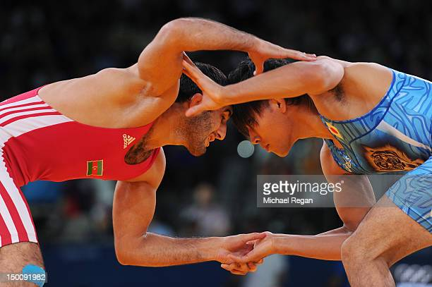 Ashraf Aliyev of Azerbaijan competes with Sohsuke Takatani of Japan in the Men's Freestyle 74 kg Wrestling on Day 14 of the London 2012 Olympic Games...