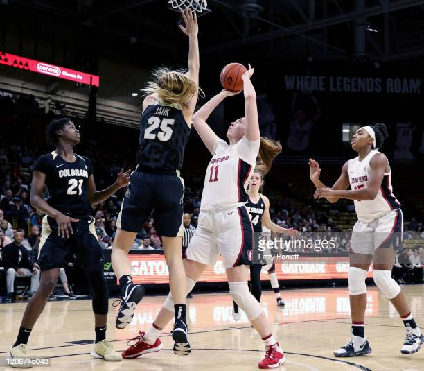 Ashten Prechtel of the Stanford Cardinal looks to make a lay up past the defense of Annika Jank of the Colorado Buffaloes during the second quarter...