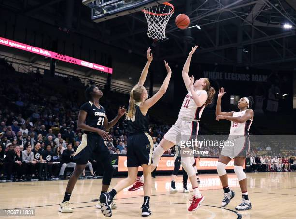 Ashten Prechtel of the Stanford Cardinal makes a lay up in front of the defense of Annika Jank and Mya Hollingshed of the Colorado Buffaloes during...