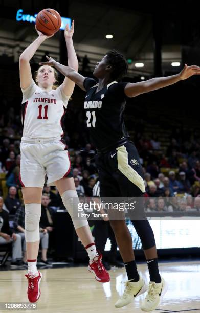 Ashten Prechtel of the Stanford Cardinal shoots over the defense of Mya Hollingshed of the Colorado Buffaloes during the first quarter of a game at...