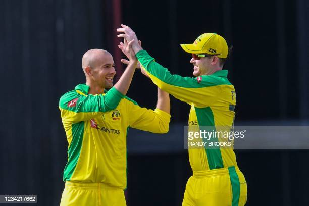 Ashton Agar and Ashton Turner of Australia celebrate the dismissal of Darren Bravo of West Indies during the 3rd and final ODI between West Indies...