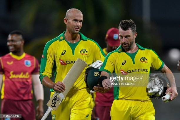 Ashton Agar and Matthew Wade of Australia chat after winning the 3rd and final ODI between West Indies and Australia at Kensington Oval, Bridgetown,...