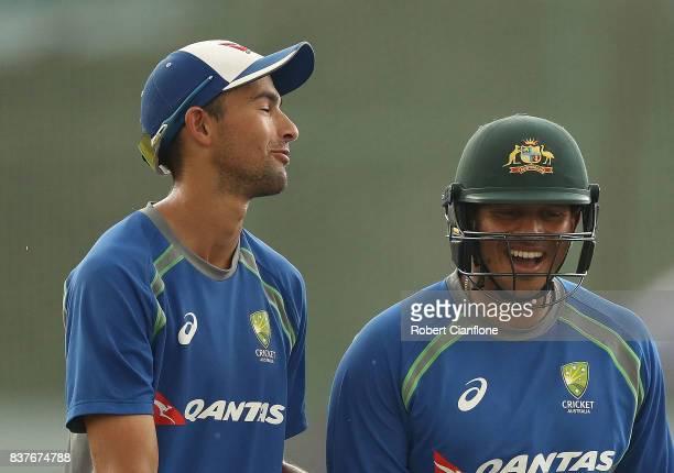 Ashton Agar and Usman Khawaja of Australia laugh during an Australian Test team nets session at SherE Bangla National Cricket Stadium on August 23...
