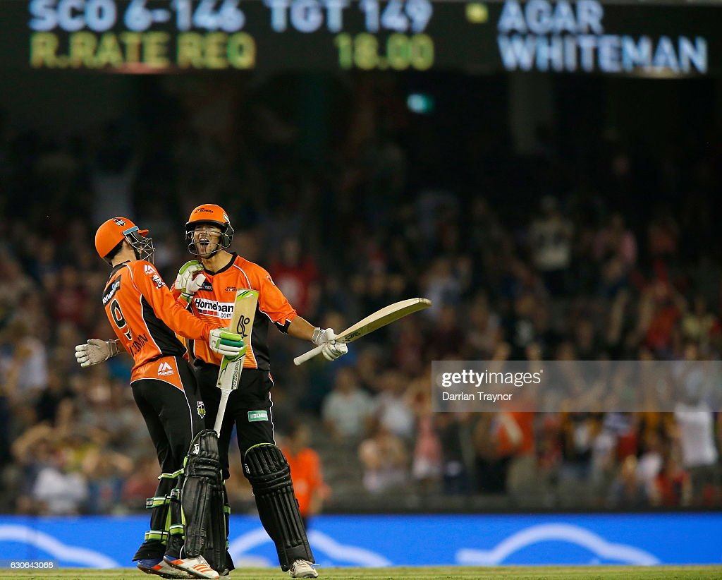Ashton Agar celebrates with team mate Sam Whitman of the Perth Scorchers after hitting a 6 on the final ball to win the Big Bash League match between the Melbourne Renegades and Perth Scorchers at Etihad Stadium on December 29, 2016 in Melbourne, Australia.