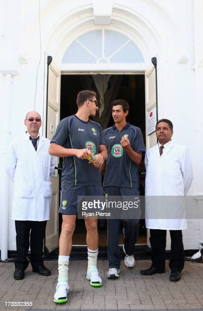Ashton Agar James Pattinson of Australia walk onto the ground before day three of the 1st Investec Ashes Test match between England and Australia at...