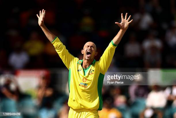 Ashton Agar of Australia celebrates after taking the wicket of KL Rahul of India during game three of the One Day International series between...