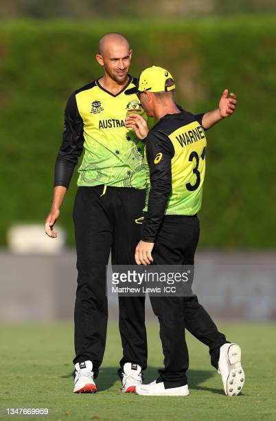 Ashton Agar of Australia celebrates the wicket of KL Rahul of India with team mate David Warner during the India and Australia warm Up Match prior to...
