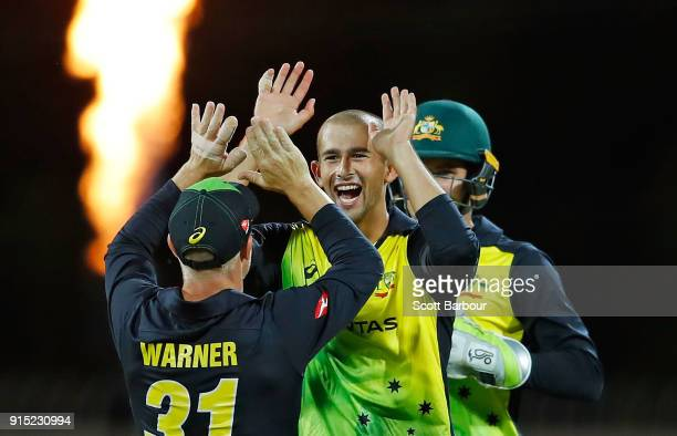 Ashton Agar of Australia celebrates with David Warner after dimissing Sam Billings of England during the Twenty20 International match between...
