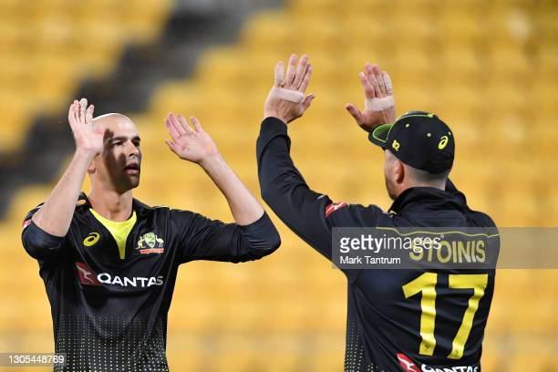 Ashton Agar of Australia congratulates Marcus Stoinis of Australia during game four of the International T20 series between New Zealand Blackcaps and...