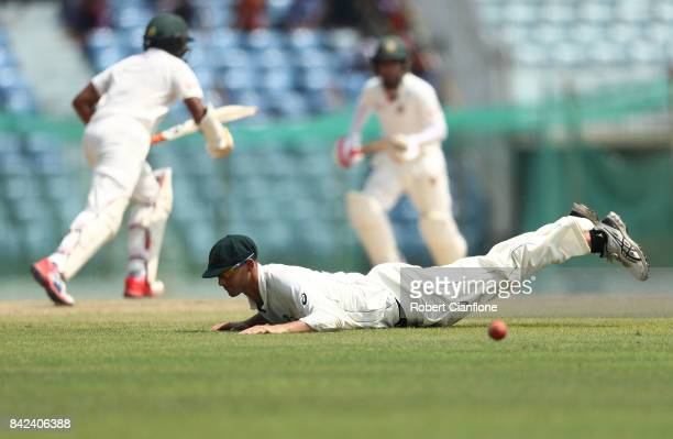 Ashton Agar of Australia dives for a ball during day one of the Second Test match between Bangladesh and Australia at Zahur Ahmed Chowdhury Stadium...