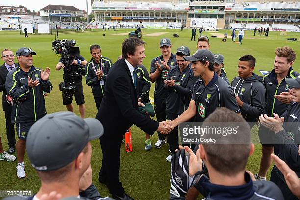 Ashton Agar of Australia receives his Baggy Green cap on his Test debut from former Australian fast bowler Glenn McGrath prior to day one of the 1st...