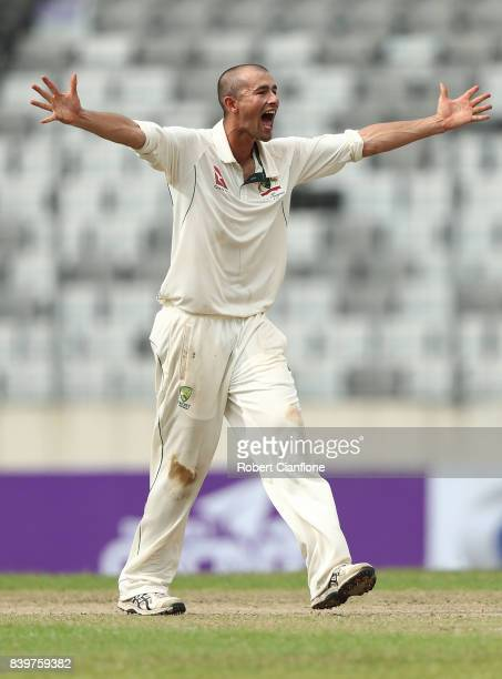 Ashton Agar of Australia takes the wicket of Mushfiqur Rahim of Bangladesh during day one of the First Test match between Bangladesh and Australia at...