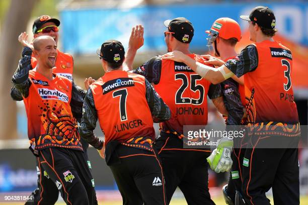 Ashton Agar of the Perth Scorchers celebrates with Mitchell Johnson of the Perth Scorchers during the Big Bash League match between the Adelaide...