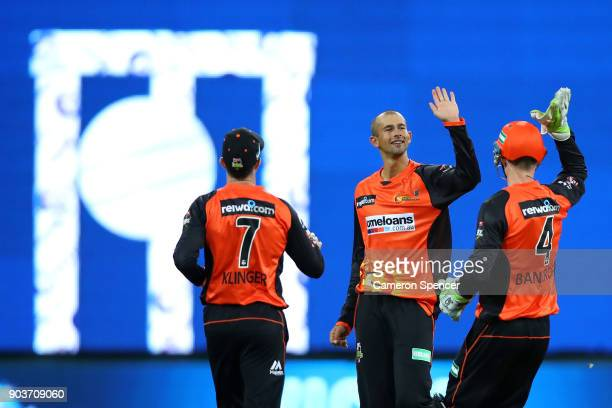 Ashton Agar of the Scorchers celebrates dismissing Usman Khawaja of the Thunder during the Big Bash League match between the Sydney Thunder and the...