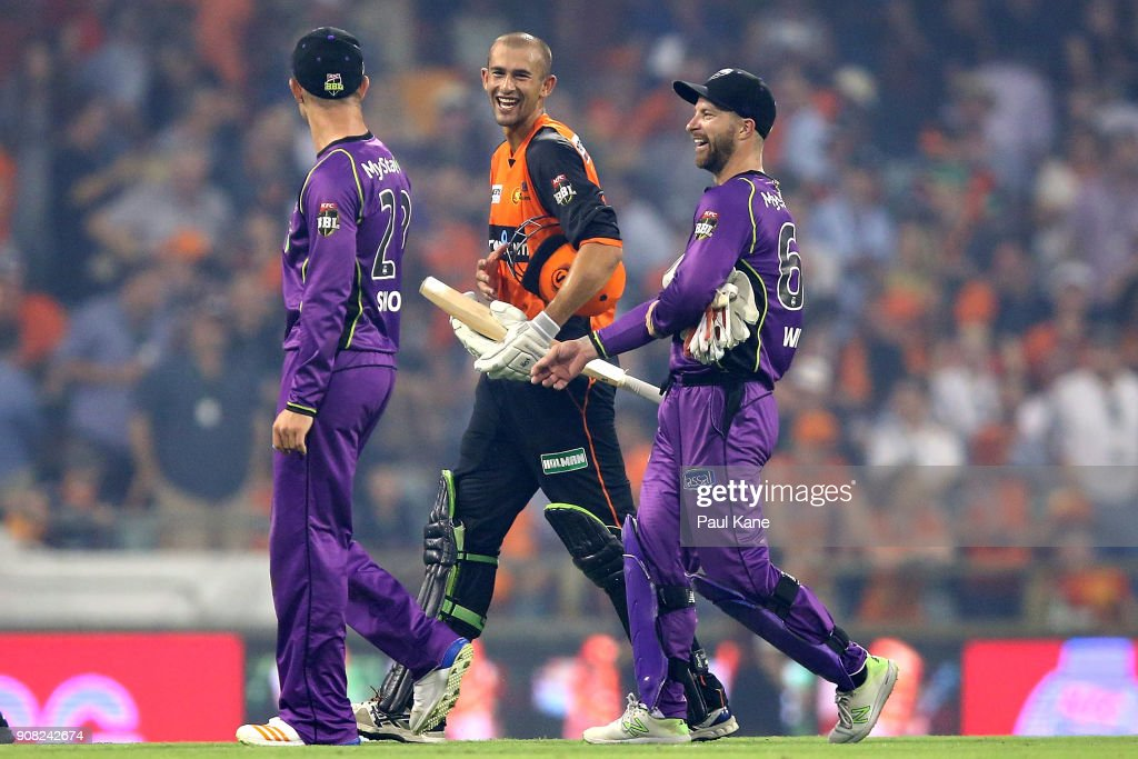 Ashton Agar of the Scorchers shares a moment with D'Arcy Short and Matthew Wade of the Hurricanes after winning the Big Bash League match between the Perth Scorchers and the Hobart Hurricanes at WACA on January 20, 2018 in Perth, Australia.