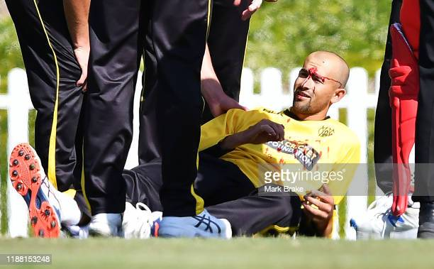 Ashton Agar of the Warriors is after being hit in the head while fielding a ball during the Marsh One Day Cup match between South Australia and...
