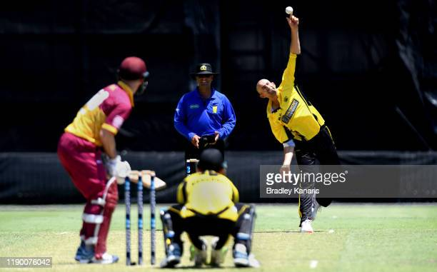 Ashton Agar of Western Australia bowls during the Marsh One Day Cup Final between Queensland and Western Australia at the Allan Border Field on...