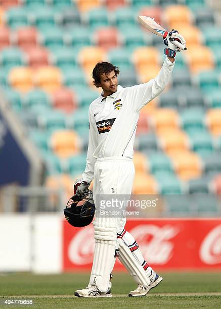 Ashton Agar of Western Australia celebrates scoring his century during day two of the Sheffield Shield match between Tasmania and Western Australia...