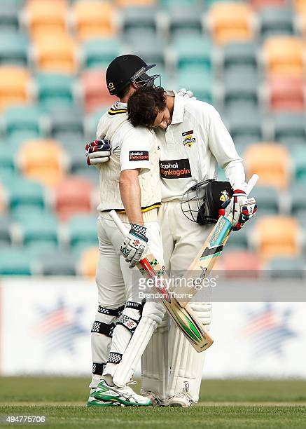Ashton Agar of Western Australia hugs team mate Michael Klinger after scoring his century during day two of the Sheffield Shield match between...