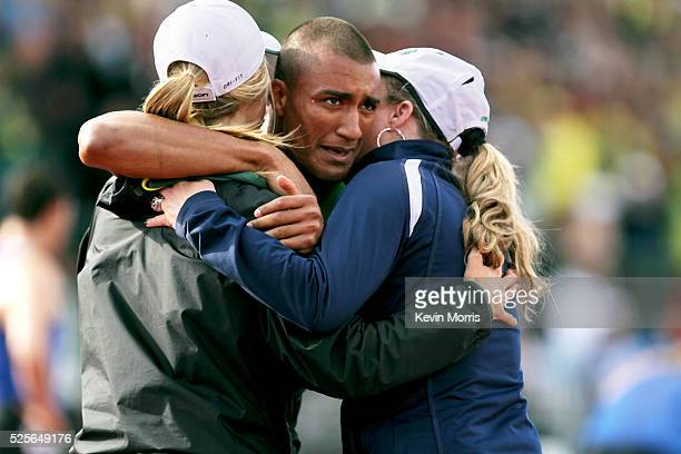 Ashton Eaton hugs mother, Roslyn, and girlfriend, Brianne after setting world record in decathlon