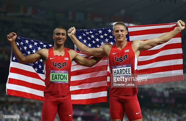 Ashton Eaton of the United States and Trey Hardee of the United States wear their nations flag as they celebrate after they won gold and silver in...