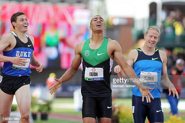 Ashton Eaton reacts after breaking the world record in the men's decathlon after competing in the 1500 meter run portion in front of Curtis Beach and...