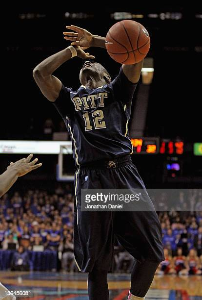 Ashton Gibbs of the Pittsburgh Panthers looses control of the ball after being fouled by a member of the DePaul Blue Demons at Allstate Arena on...