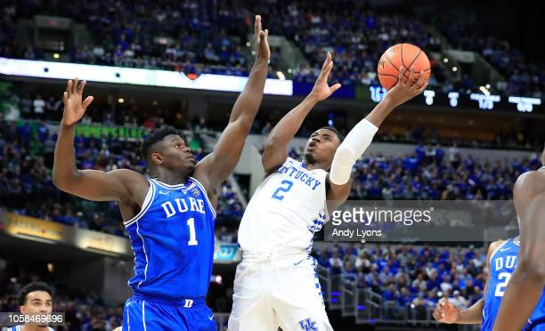 Ashton Hagan of the Kentucky Wildcats shoot the ball while defended by Zion Williamson of the Duke Blue Devils during the State Farm Champions...