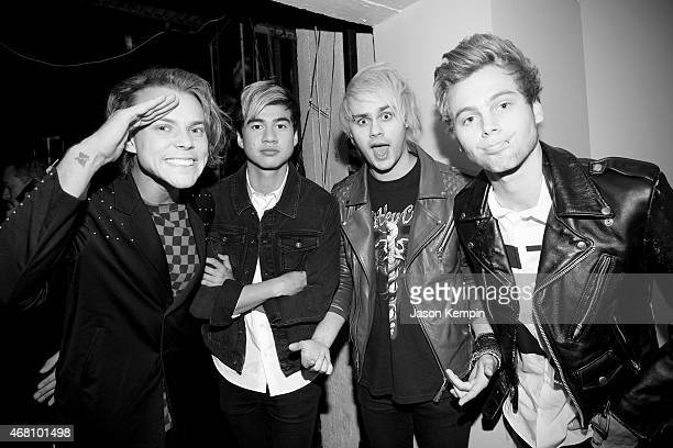 Ashton Irwin Calum Hood Michael Clifford and Luke Hemmings of the band 5 Seconds of Summer attend the 2015 iHeartRadio Music Awards On NBC on March...
