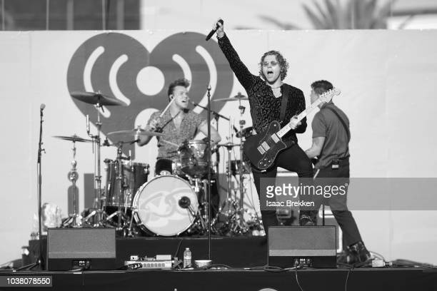 Ashton Irwin, Luke Hemmings and Calum Hood of 5 Seconds of Summer perform onstage during the 2018 iHeartRadio Music Festival Daytime Stage at the Las...