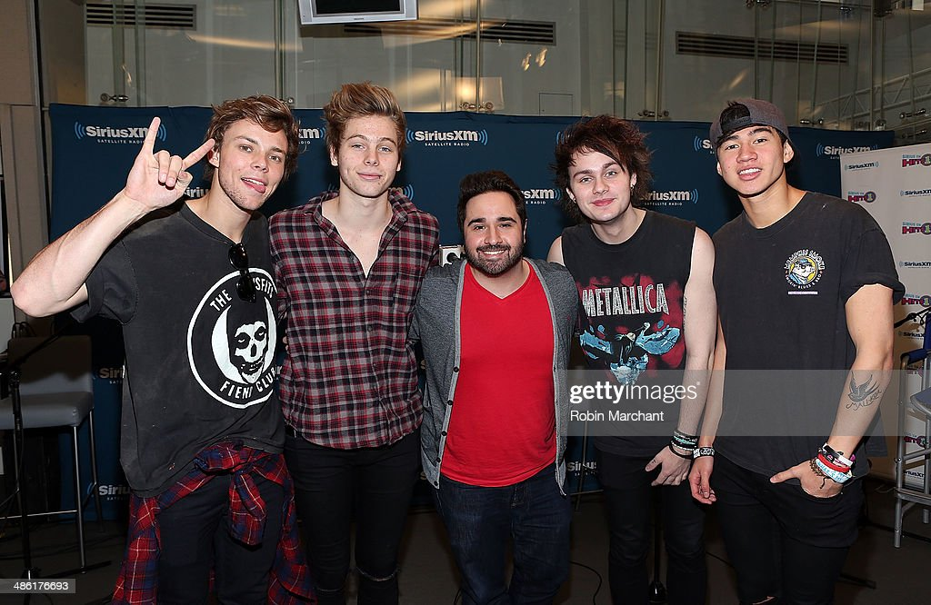 Ashton Irwin, Luke Hemmings, Michael Clifford and Calum Hood of 5 Seconds of Summer sit down for an exclusive interview with SiriusXM's Hits 1 Mikey Piff (C) at SiriusXM Studios on April 22, 2014 in New York City.
