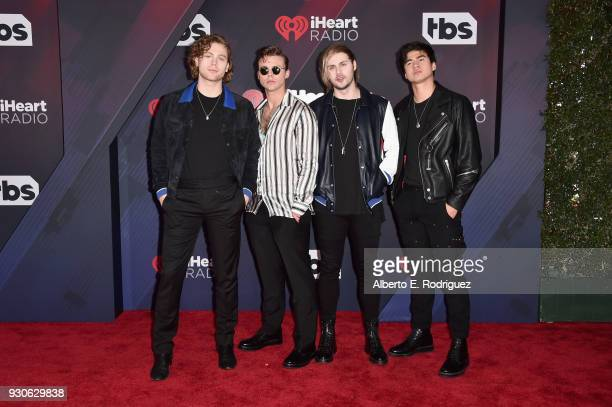 Ashton Irwin Luke Hemmings Michael Clifford and Calum Hood of 5 Seconds of Summer arrive at the 2018 iHeartRadio Music Awards which broadcasted live...