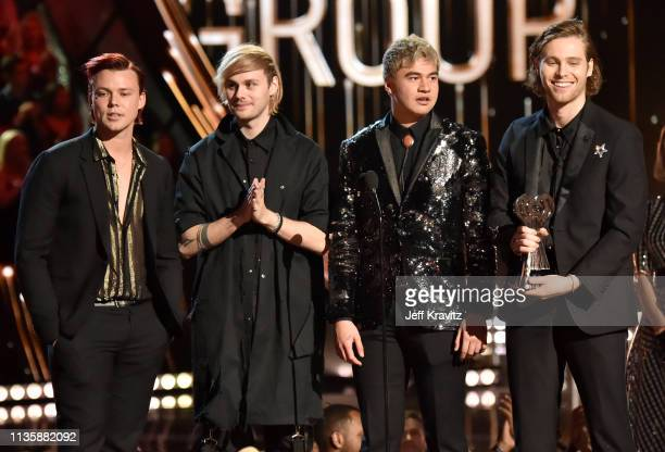 Ashton Irwin Michael Clifford Calum Hood and Luke Hemmings of 5 Seconds of Summer accept the Best Duo/Group of the Year award on stage at the 2019...