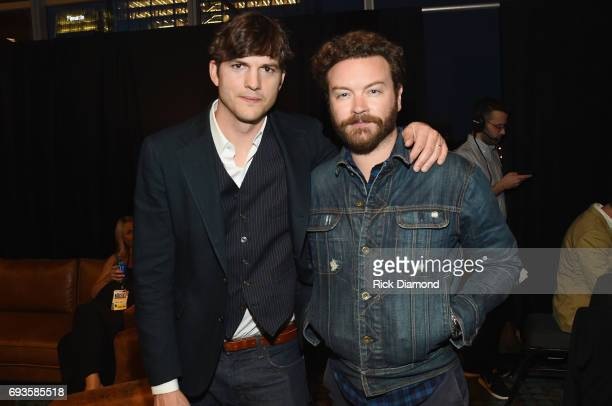 Ashton Kutcher and Danny Masterson pose backstage during the 2017 CMT Music Awards at the Music City Center on June 6 2017 in Nashville Tennessee
