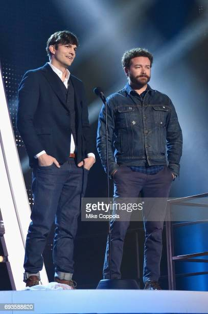 Ashton Kutcher and Danny Masterson speak onstage during the 2017 CMT Music Awards at the Music City Center on June 6 2017 in Nashville Tennessee