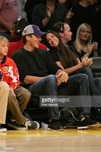 Ashton Kutcher and Demi Moore attend the Los Angeles Lakers vs Detroit Pistons match at the Staples Center on November 16 2007 in Los Angeles...