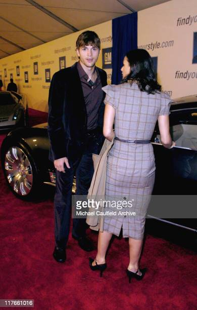 Ashton Kutcher and Demi Moore during 4th Annual 'ten' Fashion Show Presented By General Motors Red Carpet in Los Angeles California United States