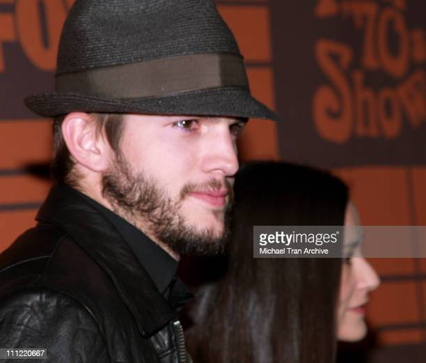 Ashton Kutcher and Demi Moore during 'That 70s Show' Series Wrap Party Arrivals at Tropicana at The Roosevelt Hotel in Hollywood California United...