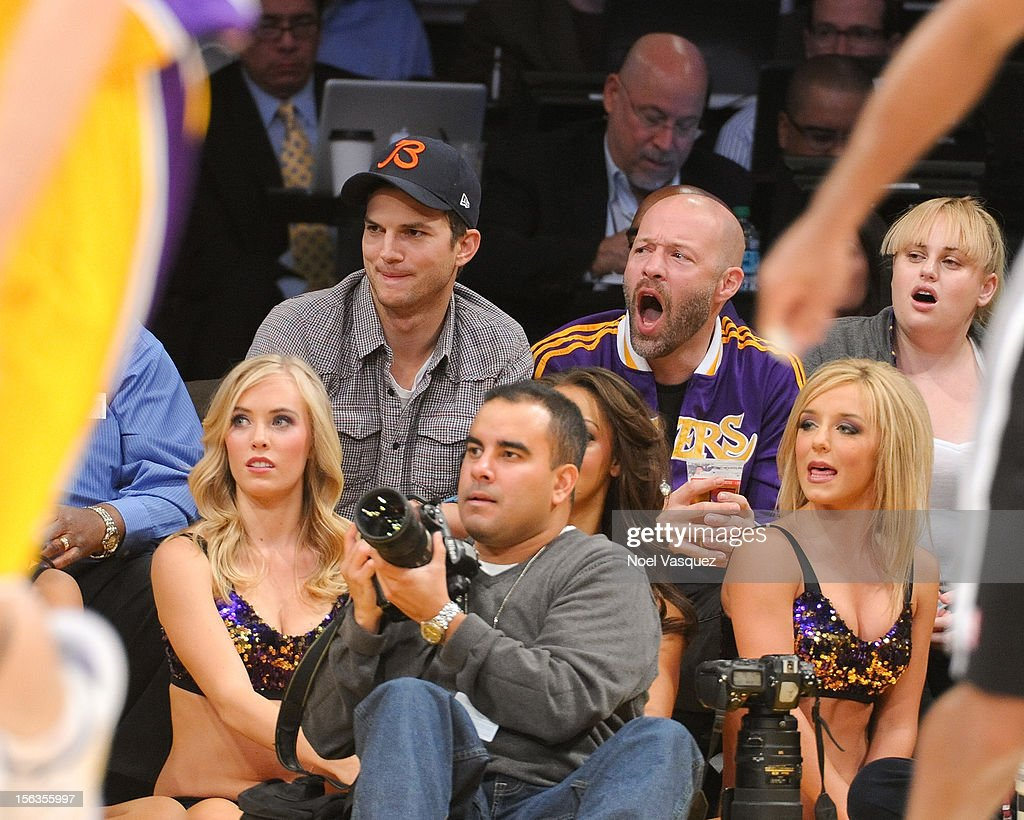 Ashton Kutcher (L) and guest attend a basketball game between the San Antonio Spurs and the Los Angeles Lakers at Staples Center on November 13, 2012 in Los Angeles, California.