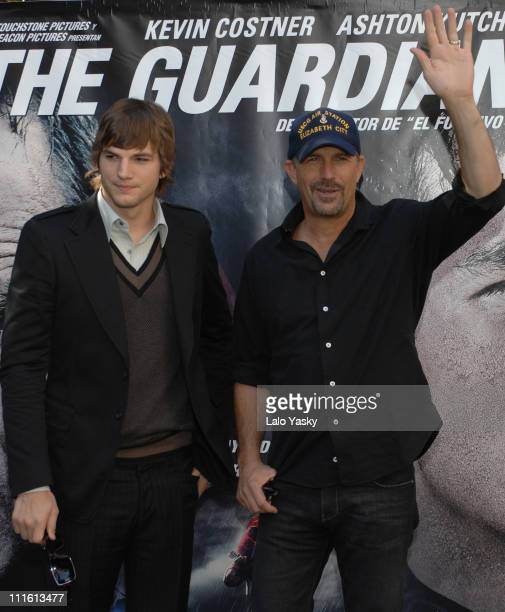 Ashton Kutcher and Kevin Costner during The Guardian Madrid Photocall at VillaMagna Hotel in Madrid Spain