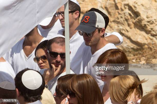 Ashton Kutcher and Mila Kunis are pictured at the funeral of Kabbalah Chief Rabbi Berg on September 18 in Safed Israel
