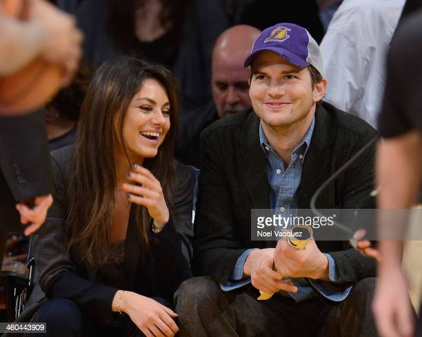 Ashton Kutcher and Mila Kunis attend a basketball game between the Utah Jazz and the Los Angeles Lakers at Staples Center on January 3, 2014 in Los...