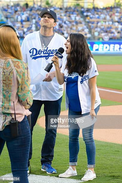 Ashton Kutcher and Mila Kunis attend game 4 of the NLCS between the Chicago Cubs and the Los Angeles Dodgers at Dodger Stadium on October 19 2016 in...