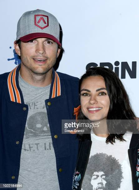 Ashton Kutcher and Mila Kunis attend the 6th annual PingPong4Purpose at Dodger Stadium on August 23 2018 in Los Angeles California