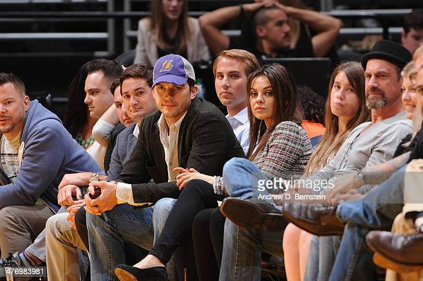 Ashton Kutcher and Mila Kunis look on during a game between the New Orleans Pelicans and the Los Angeles Lakers at Staples Center on March 4 2014 in...