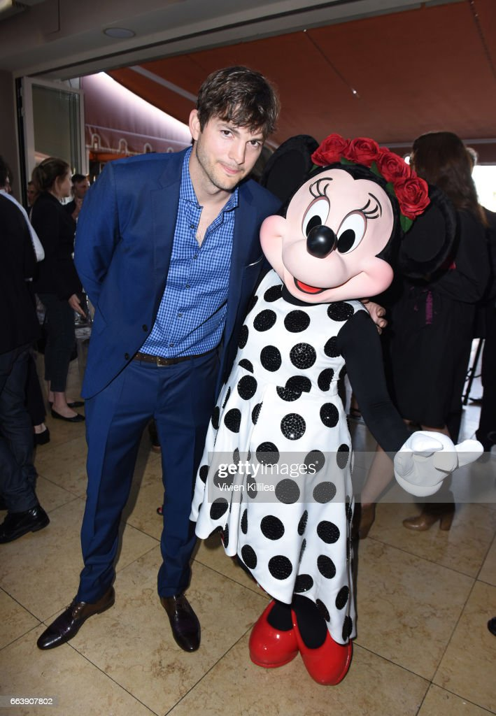Ashton Kutcher and Minnie Mouse attend Fashion LA Awards at the Sunset Tower Hotel on April 2, 2017 in West Hollywood, California. Minnie is wearing a custom alice + olivia dress by Stacey Bendet.