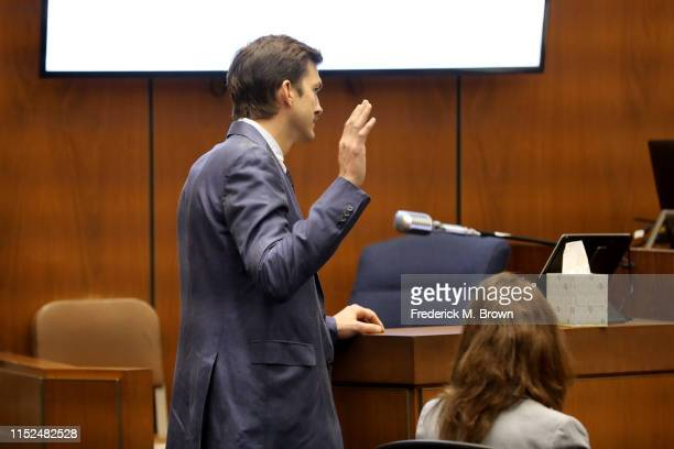 """Ashton Kutcher is sworn in before testifying during the trial of alleged serial killer Michael Gargiulo known as the """"Hollywood Ripper"""" at the Clara..."""
