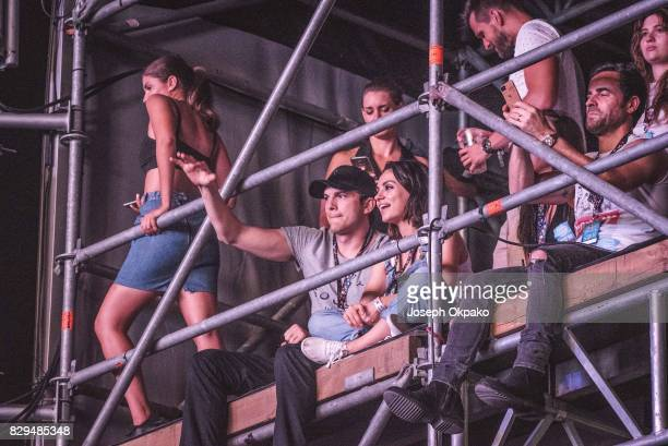 Ashton Kutcher Mila Kunis and Justin Theroux watch Wiz Khalifa's set during Day 2 of Sziget Festival 2017 on August 10 2017 in Budapest Hungary