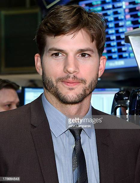 """Ashton Kutcher star of """"Jobs"""" rings the NYSE opening bell on August 6, 2013 in New York, United States."""