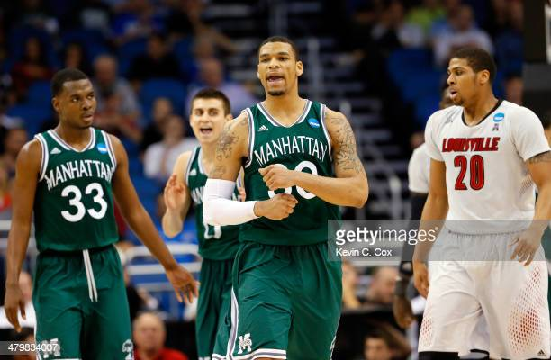 Ashton Pankey of the Manhattan Jaspers reacts after a travel call to turnover the ball against Wayne Blackshear of the Louisville Cardinals in the...